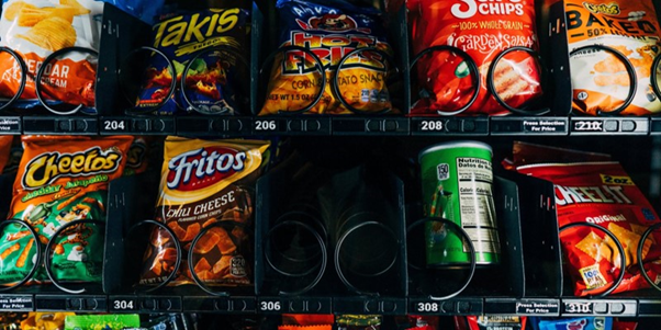 Vending Machine filled with snacks including crisps
